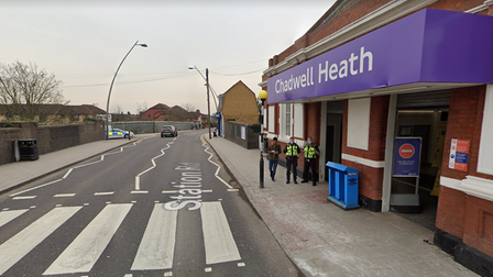 Police officers outside Chadwell Heath railway station
