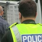 Police move into arrest John Curtin at Camp Beagle today
