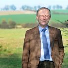 Lord Deben, John Gummer, stands in a field near his Winston home.EADT 2.6.12
