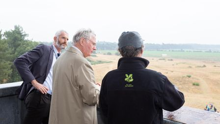 Archaeologist Angus Wainwright shows HRH The Duke of Gloucester the Sutton Hoo tower