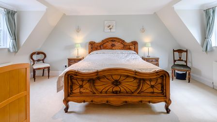 Huge double bedroom with sloping ceilings in this five-bed house for sale in Necton near Swaffham, Norfolk