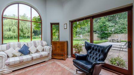 Garden room with huge arched window overlooking the garden at a property for sale in Necton near Swaffham, Norfolk