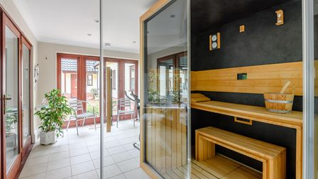 Sauna in indoor swimming pool complex at this luxury five-bed home for sale in Necton near Swaffham in Norfolk