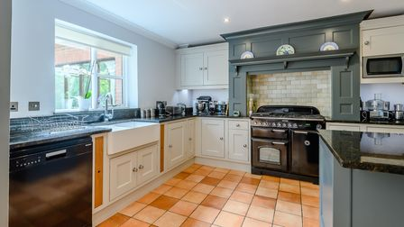 Large kitchen with range cooker and teal cabinets in five-bed house for sale in Necton, Norfolk