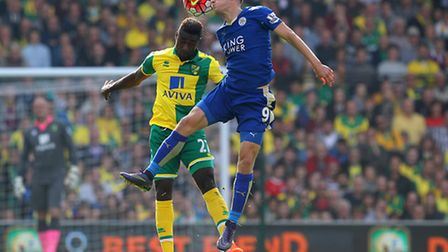 Alex Tettey and Jamie Vardy in action during the Premier League fixture between Norwich City and Lei