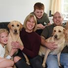 Stevie Ainsworth, former drug addict who has turned his life around, pictured with his family, wife