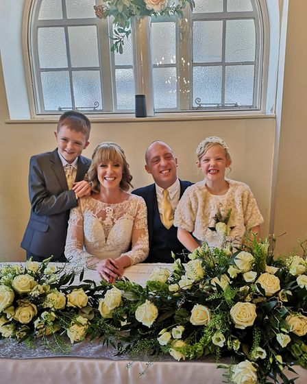 Stevie and childhood sweetheart Lisa on their wedding day, with childrenRhysand Layla.