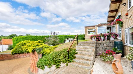 Brick-built home on a hill in Oulton, which is for sale with Minors & Brady and has far-reaching views