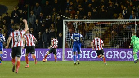 Lincoln's Nathan Arnold scores in the final minutes of the FA Cup tie against Ipswich last night