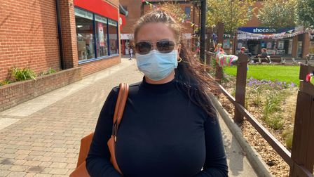 Milly Kenward, 28, from Dereham, is happy to continue wearing a face mask