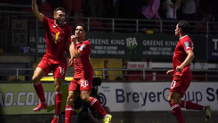 Leyton Orient's Aaron Drinan (left) celebrates scoring their side's first goal of the game during th