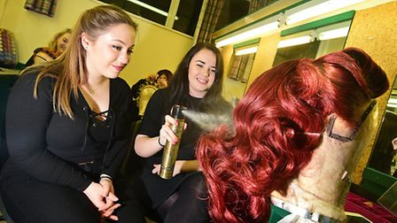 City College Norwich student Charlotte Howard, left, with Grace Gorman who is part of the wigs team