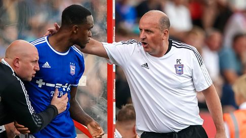 Town manager Paul Cook has words with Rekeem Harper before his second half introduction.