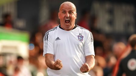 Town manager Paul Cook screams with delight at the final whistle.