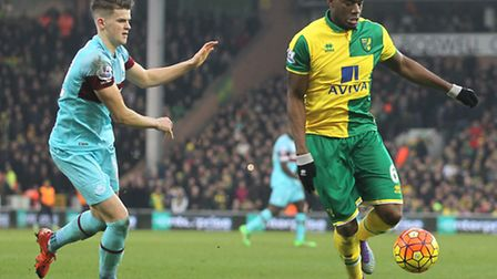 Sam Byram of West Ham and Sebastien Bassong of Norwich in action during the Barclays Premier League