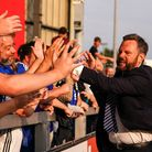 Ipswich Towns Chief Executive Officer Mark Ashton celebrates with fans.