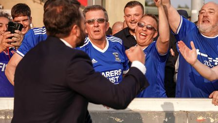 Town fans celebrate with Ipswich Towns Chief Executive Officer Mark Ashton after the victory at Linc