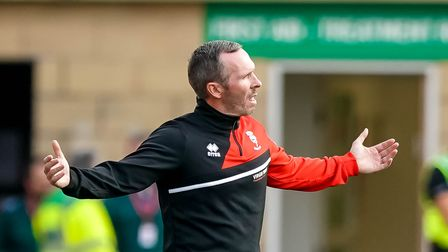 Lincoln City team manager Michael Appleton appeals after they had a goal disallowed.