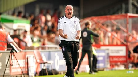 Town manager Paul Cook celebrates at the final whistle.