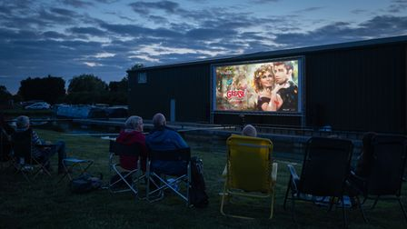 Canal boaters on Barby Moorings bank watching Grease open air film