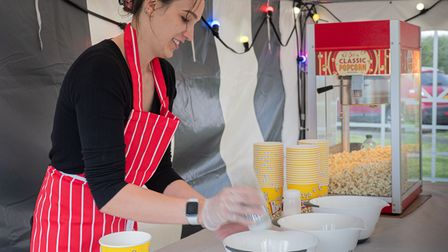 Lady in catering tent at Barby Moorings making classic cinema popcorn