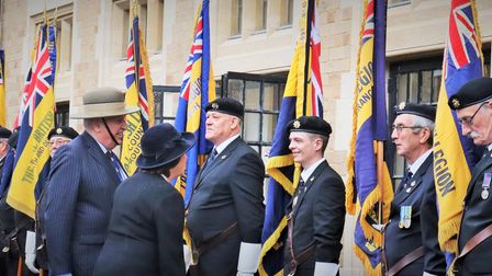 Ken Rowbottom, Suffolk RBL chairman, and Clare, Countess of Euston, with branch standard bearers