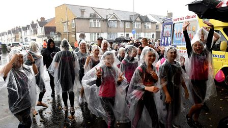 Rain fails to dampen the spirits of the young people in the parade