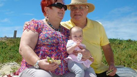 Eddie Pleban (right) and wife Jeanie with their newest granddaughter Charlotte in Perth, Australia,