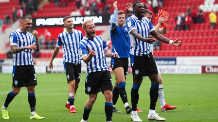 Sheffield Wednesday's Barry Bannan (centre) celebrates his team's win after the Sky Bet League One m