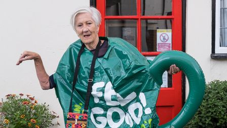 Woman dressed as a green teapot for World's Biggest Coffee Morning, Great Dunmow, Essex, September 2021