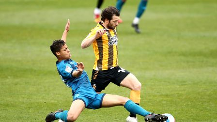 Grimsby Town's Evan Khouri (left) and Cambridge United's Wes Hoolahan battle for the ball during the