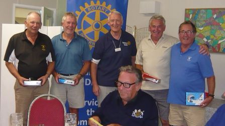 Tony Grover (centre) president of theRotary Club of Fakenham and District presents the winning team with their prizes