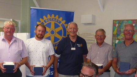 Tony Grover (centre) president of the Rotary Club of Fakenham and District presents the winning team with their prizes