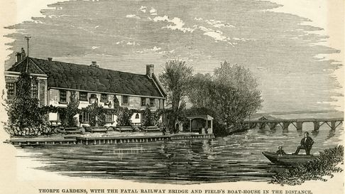 The Three Tuns on the River Yare next to the railway bridge.