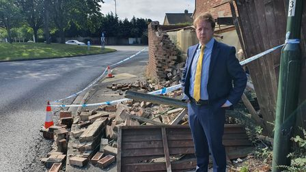 MP Paul Bristow inspects the damage caused by suspected drink driver