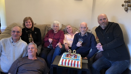 Mabel and William celebrating William's 90th birthday with their five children