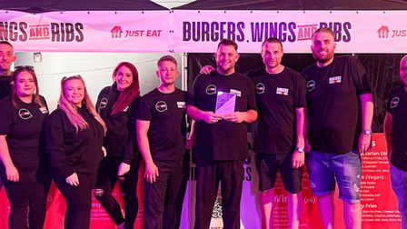 The team at Burgers Wings and Ribs with their British Takeaway Award
