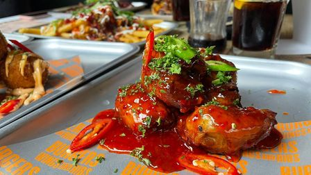 Burgers wings and ribs spicy wings with chilli and sauce