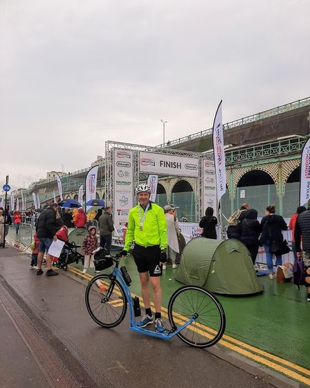 David Bird at the finish line after completing his 55-mile ride from London to Brighton.