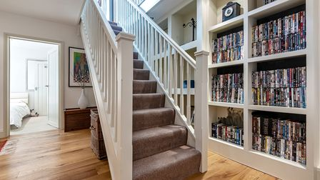 Modern hallway with staircase leading up to first floor in this two-storey historic home for sale in King's Lynn