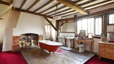 Large en suite bathroom with freestanding bath in 5-bed Suffolk manor house for sale for £1.65m