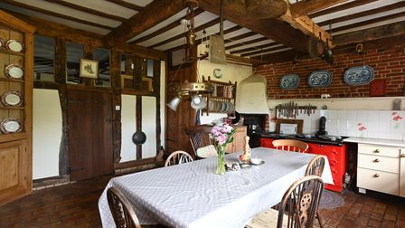 Country-style kitchen with dark wood and exposed beams in this 5-bed house for sale in Boulge, near Woodbridge, Suffolk