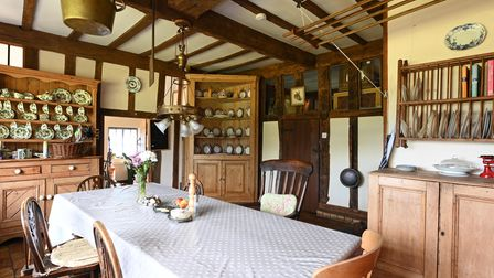 The kitchen/breakfast room with exposed timbers in this 5-bed Suffolk manor house for sale for £1.65m