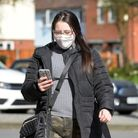 A woman walks along Princes Street in Ipswich in a mask. Stock image Picture: SARAH LUCY BROWN