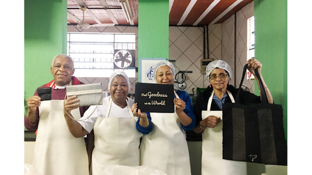 Casa de Maria volunteers with sustainable From Belo products that bear their name