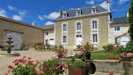 Built in a classical style, this manoir has gloriously large rooms and there's even a bar in the cel