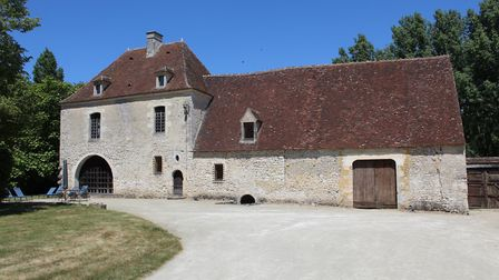 In Normandy, this renovated manoir has mullioned windows, tower with stone spiral staircase, hall w