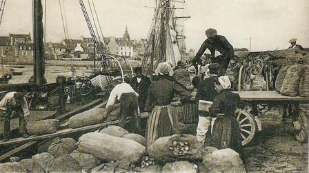 Loading stock on to a boat in Roscoff