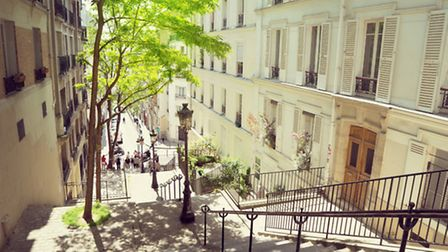 Steps lead down to one of the charming narrow streets in Montmartre © Iakov Kalinin