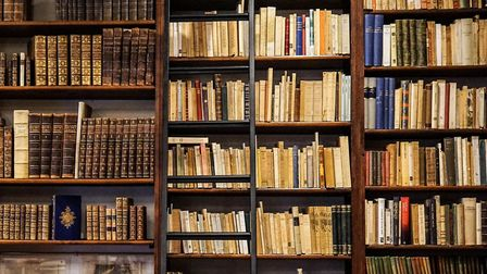 Collections of old books line the shelves in this private study © Thinkstock